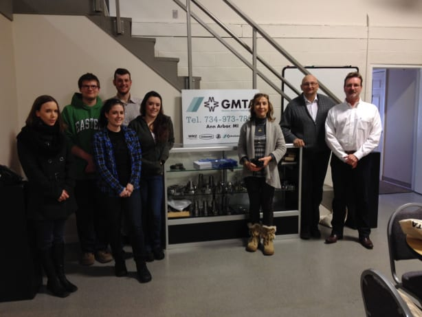 Students from Eastern Michigan University's Language and International Careers (LIC) program visited GMTA for a detailed explanation in German from the company president, Walter Friedrich, right.  Leading the group was Professor Margrit Zinggeler, Ph.D., third from the right