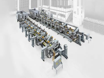 The flexible loading of the workpieces is designed specifically for the customer and fully automated. The transport system does not need to be reset and adjusts itself to individual tasks and workpiece dimensions