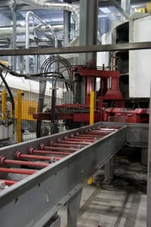 Looking over Accumulating Conveyor at Hunter HV-20 Mold Handler mold elevator