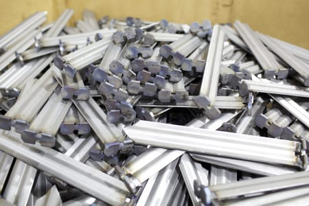 Galvanized stakes for hold downs on a satellite receiver