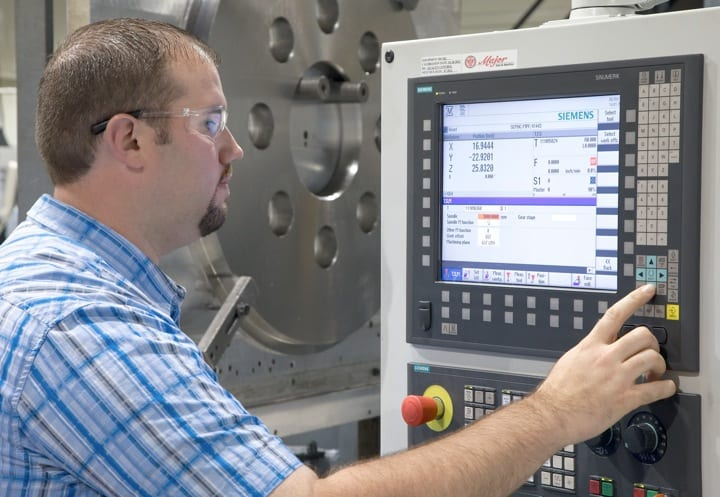 Programming as easy as 1-2-3: Using the SINUMERIK Operate interface, a machinist can turn on coolant flow by 1) pressing Cycle Stop to stop the machine, 2) Coolant On, and 3) Restart.