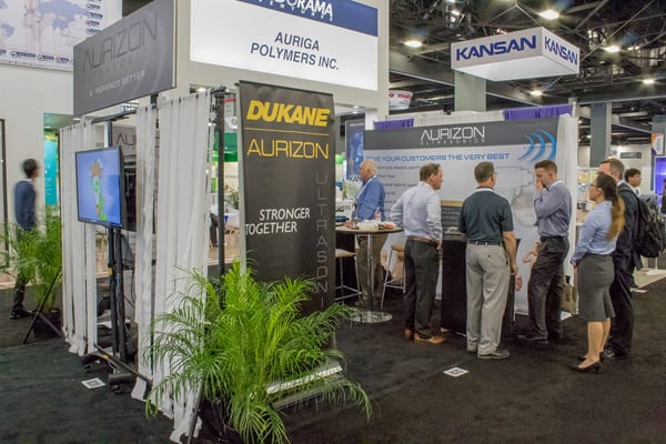 Dukane Booth at IDEA Show - Acquisition of Aurizon