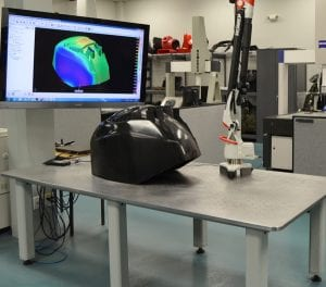 Current office setup at Exact Metrology. CT scan displayed on computer in the background